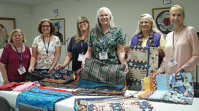 Virginia Promer, left, Patty McClearn, Marcy Raney, Sue McDonald, Linda Hill and Pattie Lascelle pose with the pillow cases they sewed during the American Sewing Guild's 900 hours of sewing for charity in 2016. On Feb. 9, 2019, Linda McGehee visited the Prescott Chapter for a trunk show and workshop. (Prescott Chapter ASG/Courtesy, file)