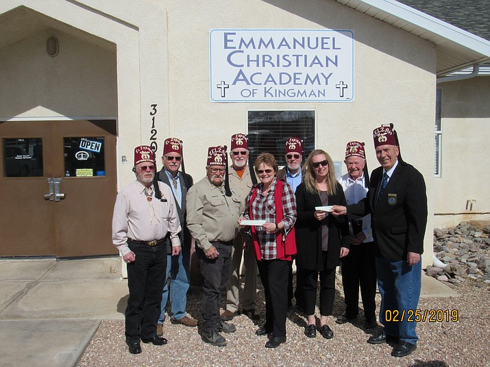 Local Shriners clubs gave students at Emmanuel Christian Academy a total of $1,400 for their upcoming trip to Washington, D.C. Pictured from left to right when the donations were given are Ken Chisem, Wayne Wissinger, Don Mason, Steve Martmartenuk, ECA Principal Barb Thofson, James Ridgway, Terra Hardcastle, Don Van Brunt, and Jon Huth of York Rite. (Photo courtesy of Kingman Shriners Club)