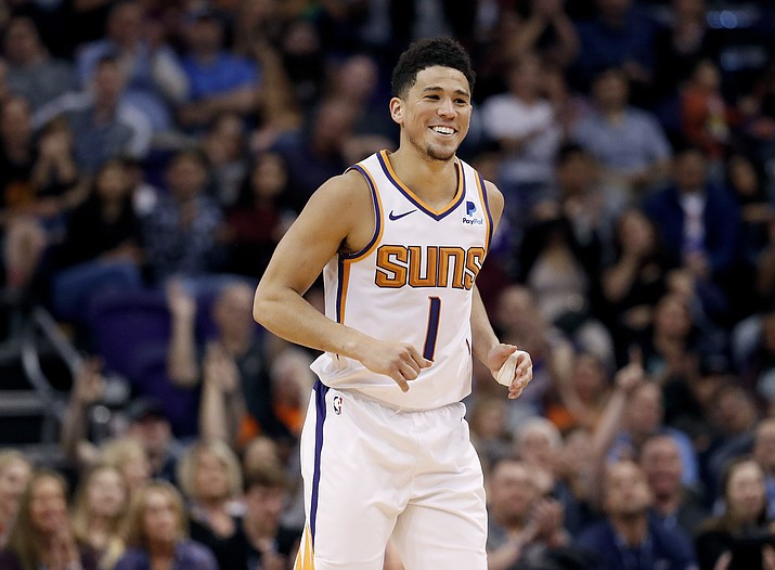 Phoenix Suns guard Devin Booker smiles after making a 3-pointer against the New York Knicks during the second half of an NBA basketball game Wednesday, March 6, 2019, in Phoenix. (Matt York/AP)