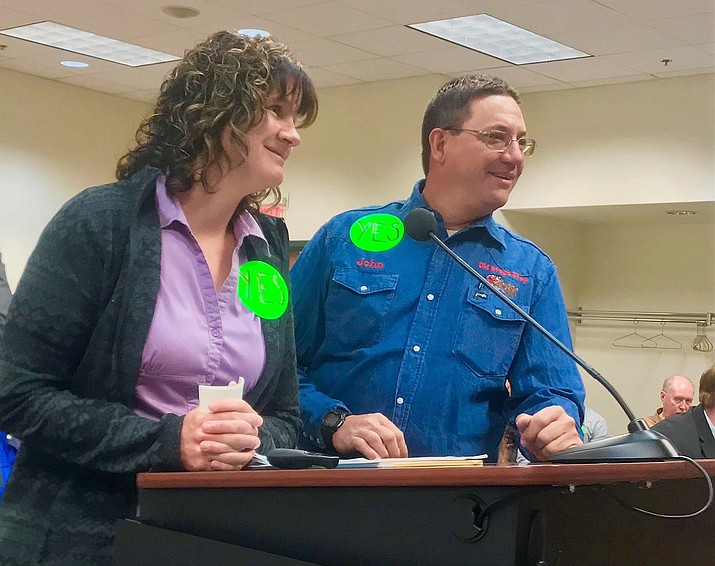 """Crystal Holmes and her brother, John R. Hunt, speak in support of a proposed cell tower, which is to be built on their family's land. Supporters of the tower wore green """"yes"""" stickers. (George Johnston/Courier)"""