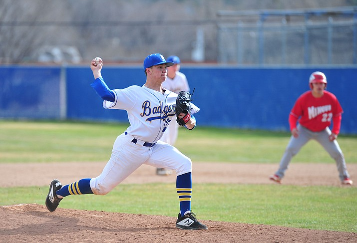 Prescott's JakeSchulz delivers a pitch as the Badgers host the Mingus Marauders Thursday, March 7, 2019, in their home opener for the 2019 season. (Les Stukenberg/Courier)