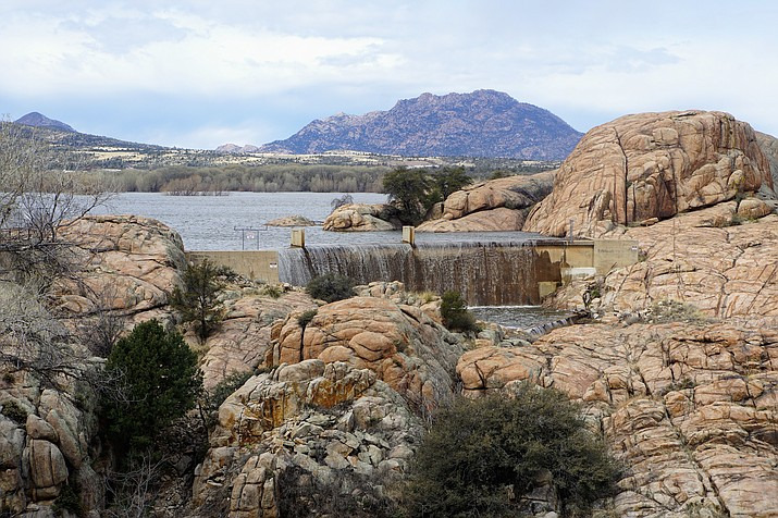 Because of differences in the watersheds that feed Prescott's two Granite Dells-area lakes, Willow Lake fills up less often than does nearby Watson Lake. But with the runoff from Prescott's massive snowstorm on Feb. 21 to 23, Willow Lake began overflowing at its spillway on March 3, 2019. (Cindy Barks/Courier)