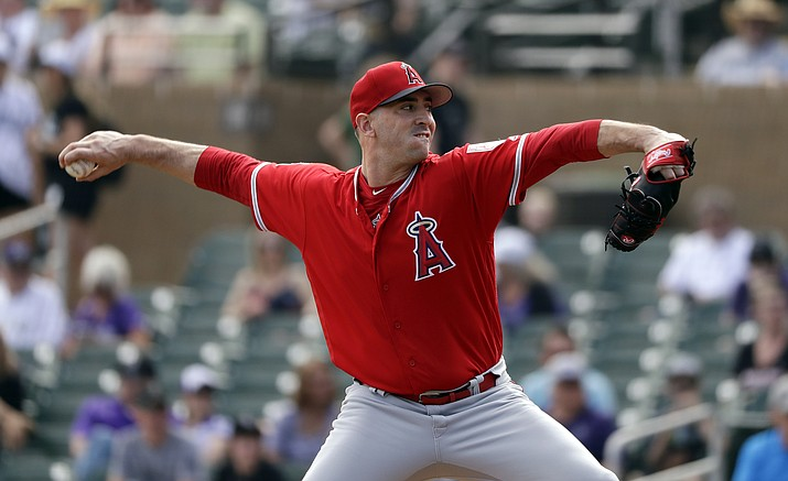 Los Angeles Angels starting pitcher Matt Harvey throws against the Colorado Rockies in the first inning of a spring training baseball game Wednesday, March 6, 2019, in Scottsdale. (Elaine Thompson/AP)