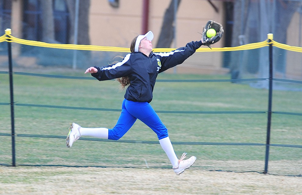 Prescott's Dana Seavey makes a running grab in center field as the Badgers host Seton Catholic on a blustery day Friday, March 8, 2019. Les Stukenberg/Courier)