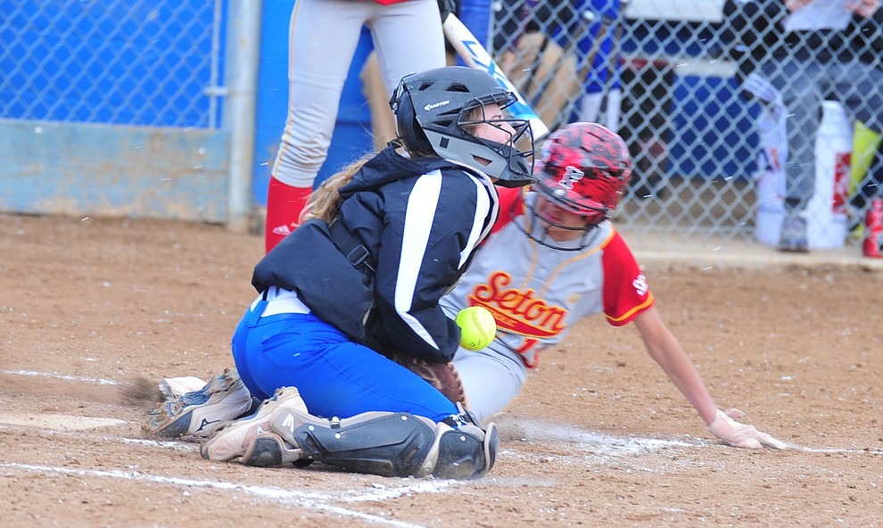 Prescott's Danner Cozens tries to get the out at home as the Badgers host Seton Catholic on a blustery day Friday, March 8, 2019. Les Stukenberg/Courier)