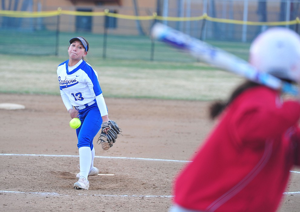 Prescott's Makayla Reyes delivers a pitch as the Badgers host Seton Catholic on a blustery day Friday, March 8, 2019. Les Stukenberg/Courier)
