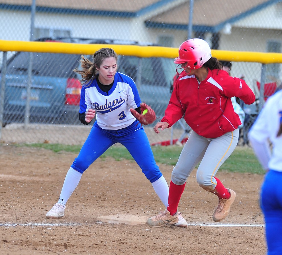 Prescott's Morgan Little tries to get the out at third as the Badgers host Seton Catholic on a blustery day Friday, March 8, 2019. Les Stukenberg/Courier)