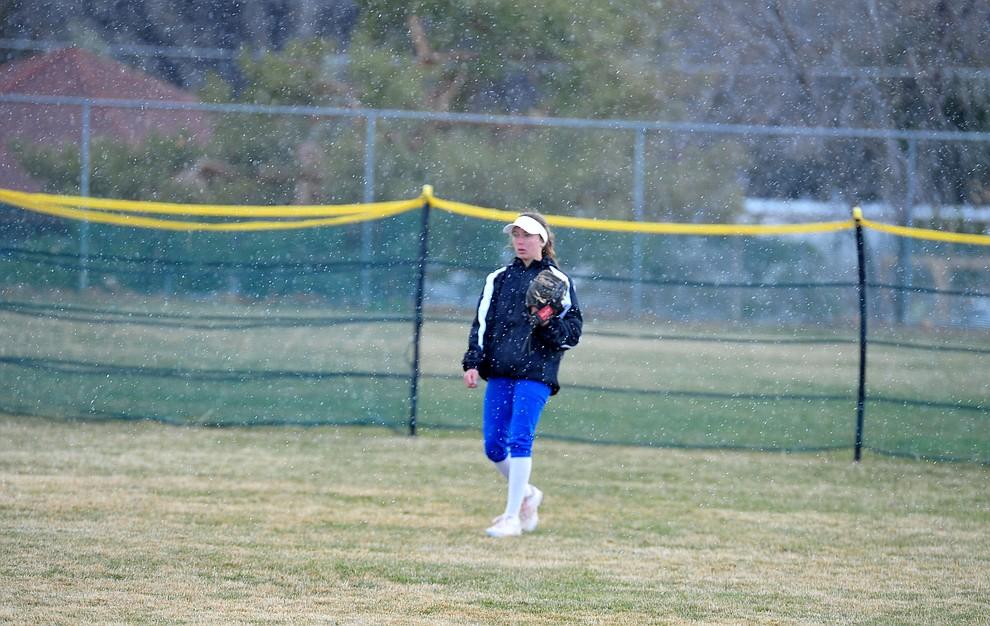 Prescott center fielder Dana Seavey stands in the freezing rain as the Badgers host Seton Catholic on a blustery day Friday, March 8, 2019. Les Stukenberg/Courier)