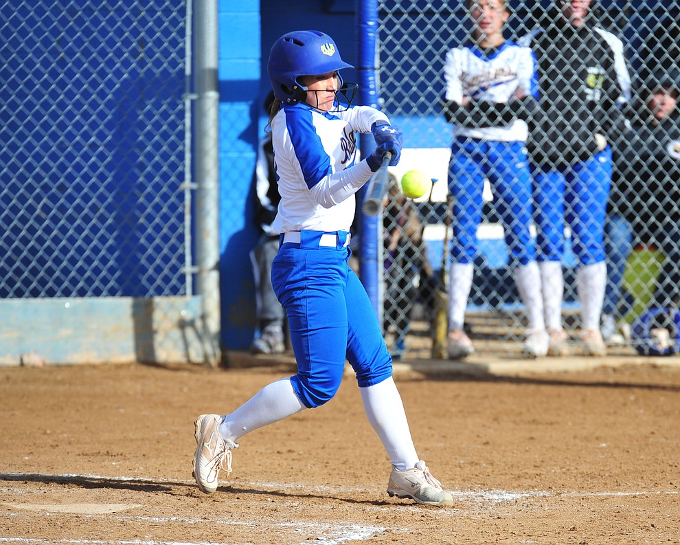 Prescott's Makayla Reyes hits a solo home run in the first inning as the Badgers host Seton Catholic on a blustery day Friday, March 8, 2019. Les Stukenberg/Courier)