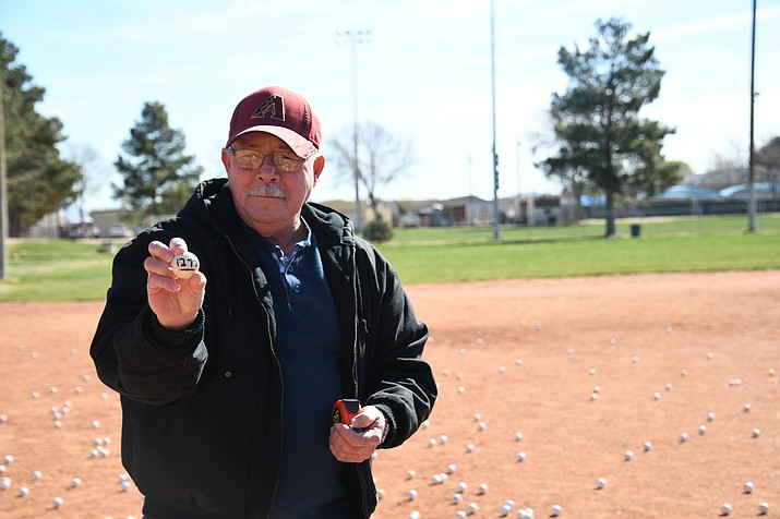 Judge John Taylor holds the winning golf ball. The Kingman Mohave Lions Club held its largest 50/50 fundraiser to raise money for the different service projects they provide the community. They raised over $3,500 to go toward the projects. (Photo by Vanessa Espinoza/Daily Miner)