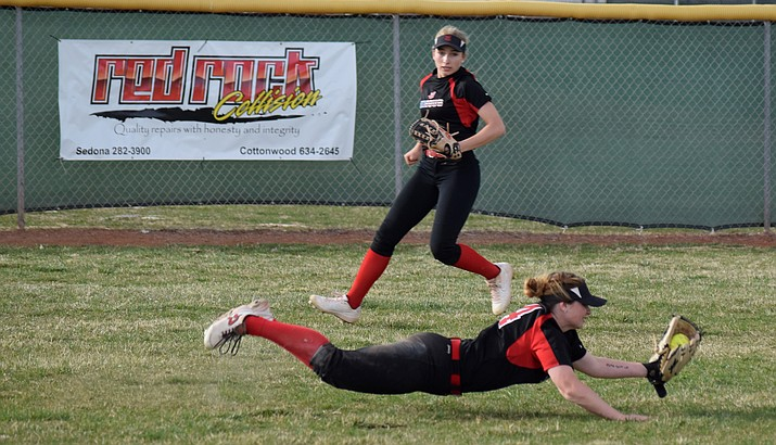 Mingus senior Paige Bartel dives to catch a fly ball during the Marauders' 16-1 win over Prescott on Thursday at home. VVN/James Kelley
