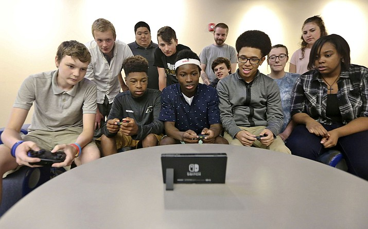 Eisenhower High School students in Decatur, Ill., play a video game after the school announced it is starting an e-sport competitive gaming team. New Mexico is joining Illinois and a handful of other states in allowing high school students to participate in the growing sport of e-sports. (Clay Jackson/Herald & Review via AP, File)