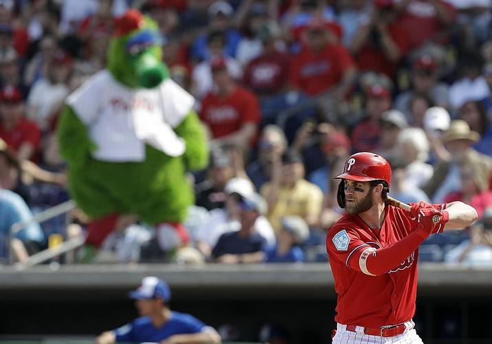 Philadelphia Phillies' Bryce Harper bats against the Toronto Blue Jays during the third inning Saturday, March 9, 2019, in Clearwater, Fla. (Chris O'Meara/AP)