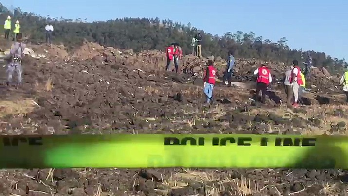 In this image taken from video, rescuers search through wreckage at the scene of an Ethiopian Airlines flight that crashed shortly after takeoff at Hejere near Bishoftu, or Debre Zeit, some 50 kilometers (31 miles) south of Addis Ababa, in Ethiopia Sunday, March 10, 2019. The Ethiopian Airlines flight crashed shortly after takeoff from Ethiopia's capital on Sunday morning, killing all 157 on board, authorities said, as grieving families rushed to airports in Addis Ababa and the destination, Nairobi. (Yidnek Kirubel/AP)