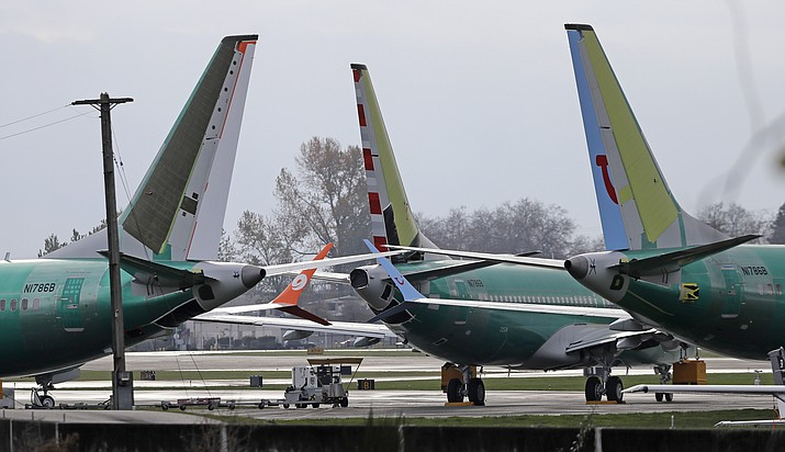 In this Nov. 14, 2018, file photo Boeing 737 MAX 8 planes are parked near Boeing Co.'s 737 assembly facility in Renton, Wash. Investigators were rushing to the scene of a devastating plane crash in Ethiopia on Sunday, March 10, 2019, an accident that could renew safety questions about the newest version of Boeing's popular 737 airliner. (Ted S. Warren/AP, File)