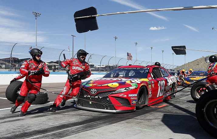 Driver Kyle Busch makes a pit stop on lap 153 during the NASCAR Cup Series auto race at ISM Raceway, Sunday, March 10, 2019, in Avondale, Ariz. (Ralph Freso/AP)