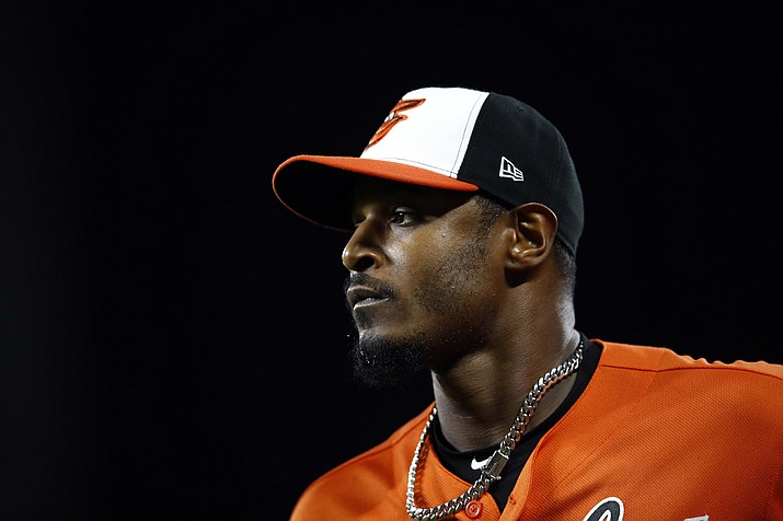 This Sept. 29, 2018, shows Baltimore Orioles right fielder Adam Jones running off the field between innings of the second baseball game of a doubleheader against the Houston Astros, in Baltimore. Jones and the Arizona Diamondbacks have agreed to a one-year contract, a source told the AP. (Patrick Semansky/AP, File)