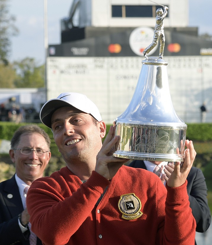 Francesco Molinari lifts the championship trophy after winning the Arnold Palmer Invitational golf tournament Sunday, March 10, 2019, in Orlando, Fla. (Phelan M. Ebenhack/AP)