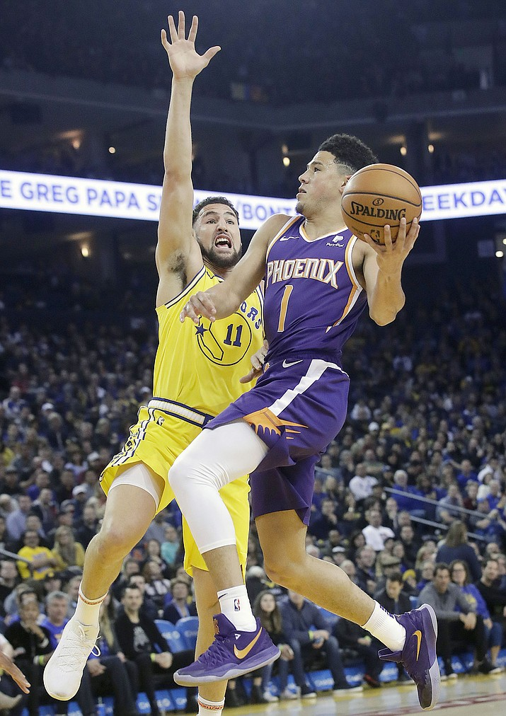 84105d09eb0c Phoenix Suns guard Devin Booker (1) shoots against Golden State Warriors  guard Klay Thompson