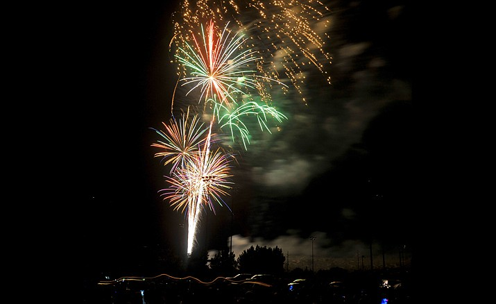 Bright colors rain down from the sky while the 2015 Fourth of July fireworks erupt over Pioneer Park in Prescott. (Matt Hinshaw/Courier, file)