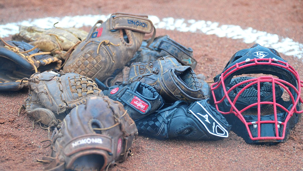 Bradshaw Mountain gloves await their players before the Bears take on Coconino in a steady rainfall, Monday, March 11, 2019, in Prescott Valley. Les Stukenberg/Courier)