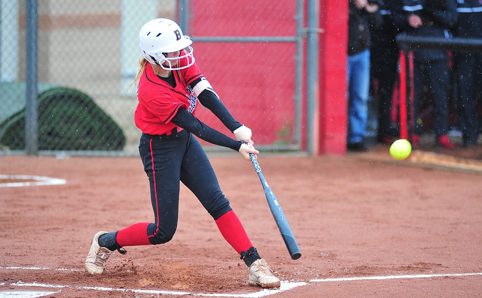 Bradshaw Mountain's Kassidy Outlaw drives a single as the Bears take on Coconino in a steady rainfall, Monday, March 11, 2019, in Prescott Valley. Les Stukenberg/Courier)