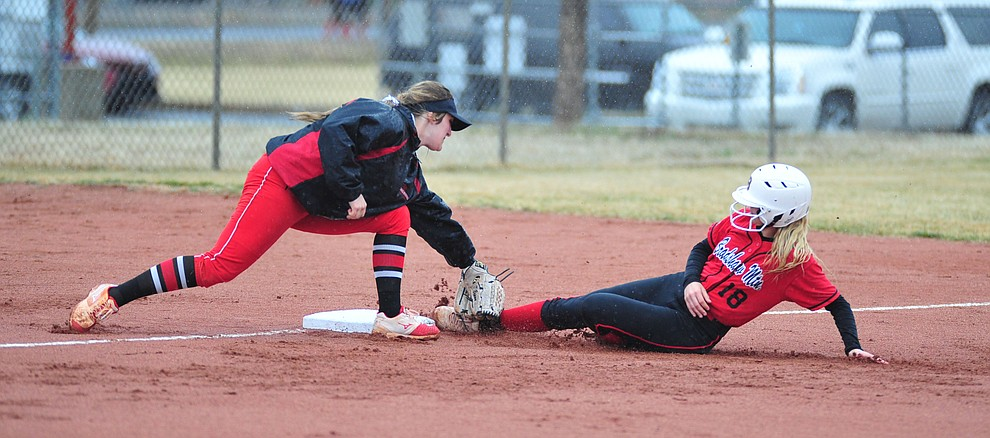 Bradshaw Mountain's Kassidy Outlaw steals third base as the Bears take on Coconino in a steady rainfall, Monday, March 11, 2019, in Prescott Valley. Les Stukenberg/Courier)