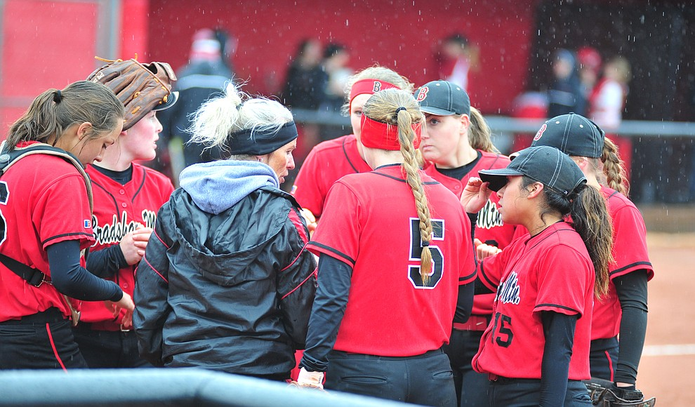 Bradshaw Mountain Head Coach Sharon Haese talks to her players as the Bears take on Coconino in a steady rainfall, Monday, March 11, 2019, in Prescott Valley. Les Stukenberg/Courier)
