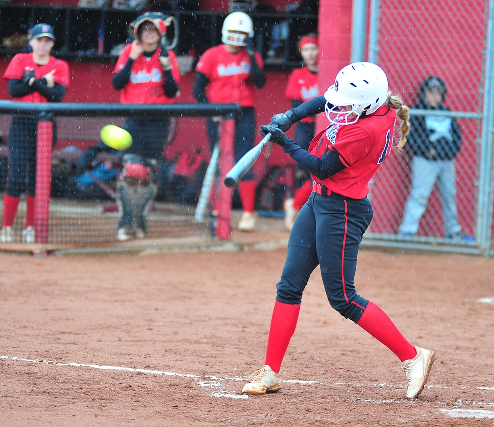 Bradshaw Mountain's Jacie Hambrick drives a double to right field as the Bears take on Coconino in a steady rainfall, Monday, March 11, 2019, in Prescott Valley. Les Stukenberg/Courier)
