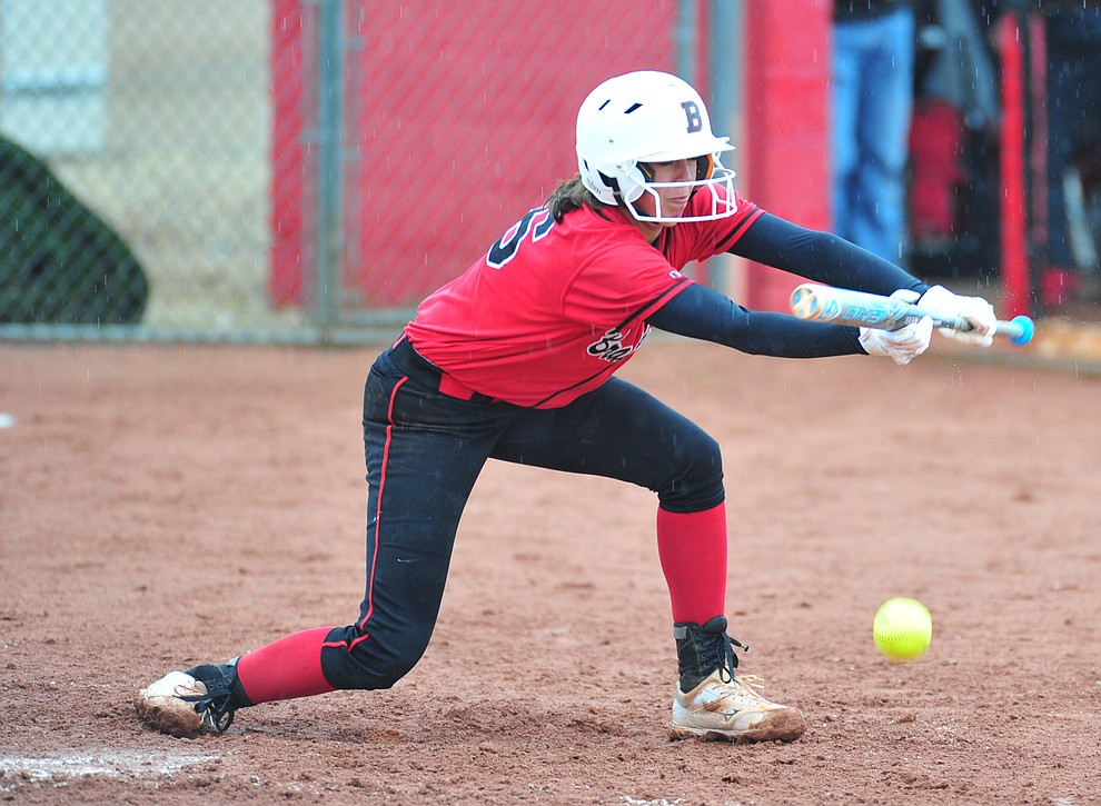 Bradshaw Mountain's Layla Stouder lays down a bunt as the Bears take on Coconino in a steady rainfall, Monday, March 11, 2019, in Prescott Valley. Les Stukenberg/Courier)