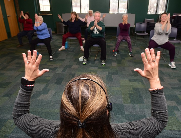 Instructor Lori Wallach leads the monthly Chair Yoga class Friday, March 8, 2019 at the Prescott Public Library. (Les Stukenberg/Courier)