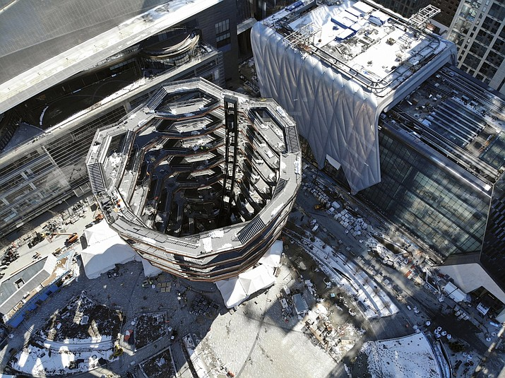 "This March 5, 2019, photo taken with a drone shows ""Vessel,"" a 150-foot-tall structure of climbable interlocking staircases, that is the center point of the $25 billion Hudson Yards Redevelopment in New York. The climbable structure designed by Thomas Heatherwick opens to the public on Friday, March 15, 2019. (AP Photo/Ted Shaffrey)"