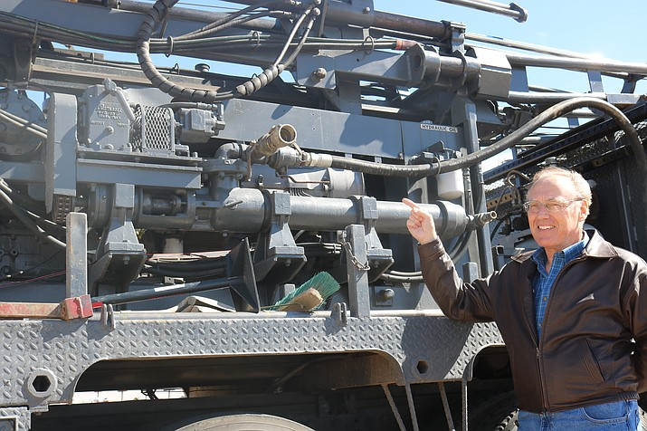Airport Manager Steve Johnston points to the machinery being used to take core samples from the dross site at the Kingman Airport. (Photo by Travis Rains/Daily Miner)