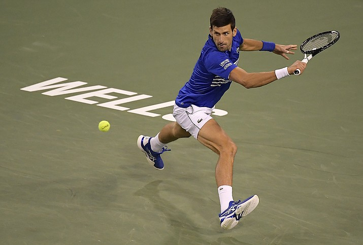 Novak Djokovic, of Serbia, returns a shot to Philipp Kohlschreiber, of Germany, at the BNP Paribas Open tennis tournament Monday, March 11, 2019, in Indian Wells, Calif. (Mark J. Terrill/AP)
