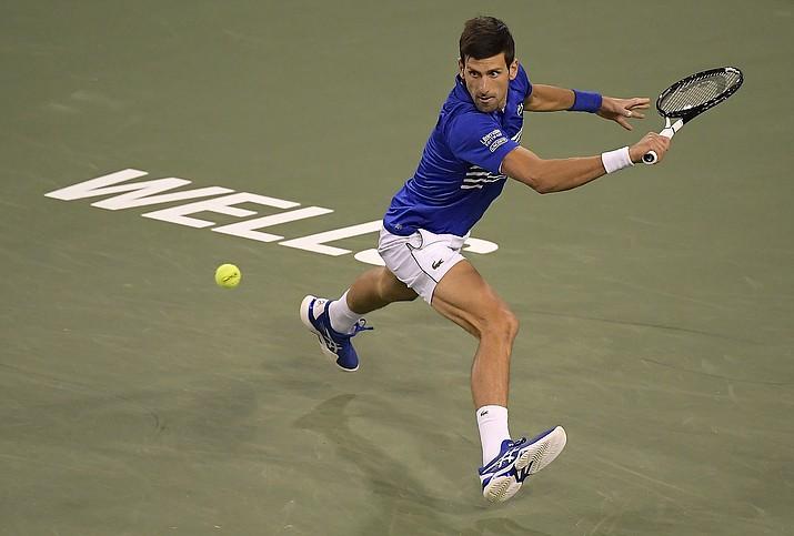 Novak Djokovic, of Serbia, returns a shot to Philipp Kohlschreiber, of Germany, at the BNP Paribas Open tennis tournament Monday, March 11, 2019, in Indian Wells, Calif. (Mark J. Terrill/AP)