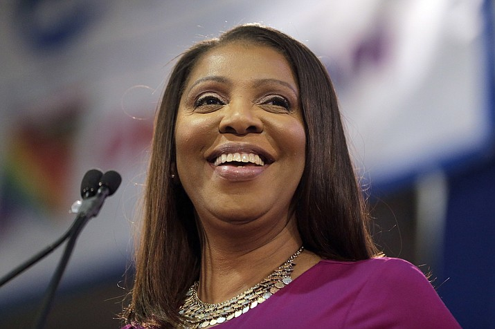 In this Jan. 6, 2019 file photo, Attorney General of New York, Letitia James, smiles during an inauguration ceremony in New York. James has opened a civil investigation into President Donald Trump's business dealings, taking action after his former lawyer told Congress he exaggerated his wealth to obtain loans. A person familiar with the inquiry said James issued subpoenas Monday, March 11, to Deutsche Bank and Investors Bank seeking records related to four Trump real estate projects and his failed 2014 bid to buy the NFL's Buffalo Bills. (Seth Wenig/AP, File)