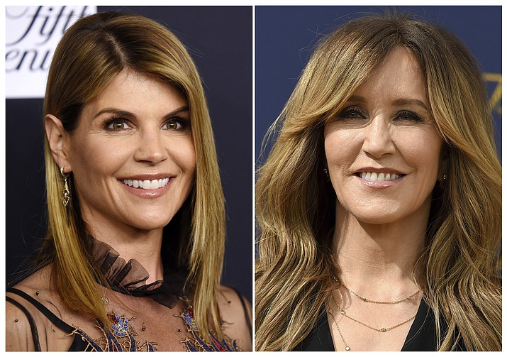 This combination photo shows actress Lori Loughlin at the Women's Cancer Research Fund's An Unforgettable Evening event in Beverly Hills, Calif., on Feb. 27, 2018, left, and actress Felicity Huffman at the 70th Primetime Emmy Awards in Los Angeles on Sept. 17, 2018. Loughlin and Huffman are among at least 40 people indicted in a sweeping college admissions bribery scandal. Both were charged with conspiracy to commit mail fraud and wire fraud in indictments unsealed Tuesday in federal court in Boston. (AP Photos)