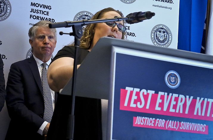 Manhattan District Attorney Cyrus Vance, left, listens while sexual assault survivor Tracy Rios speaks about her attack, during a press conference, Tuesday March 12, 2019, in New York. Vance released results of a $38 million national initiative to help law enforcement agencies perform DNA tests on evidence in thousands of languishing rape cases. (Bebeto Matthews/AP)