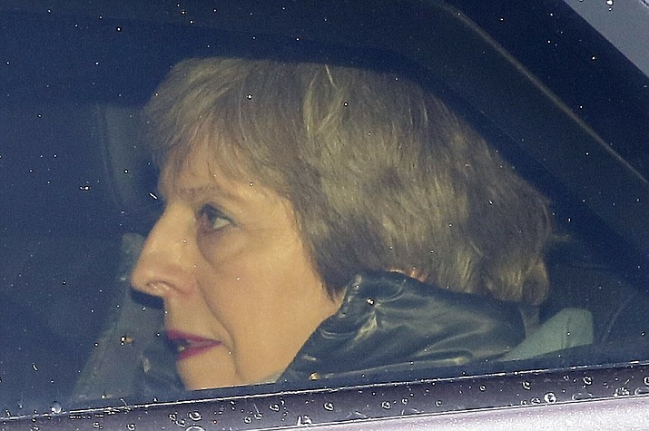 Britain's Prime Minister Theresa May arrives back at the the Houses of Parliament in London, Tuesday, March 12, 2019. Britain's Parliament delivered a crushing defeat to Prime Minister Theresa May's European Union divorce deal Tuesday, plunging the Brexit process into chaos just 17 days before the U.K. is due to leave the bloc. Lawmakers rejected the deal 391-242, ignoring May's entreaties to back the agreement and end the political chaos and economic uncertainty that Brexit has unleashed. (Tim Ireland/AP)
