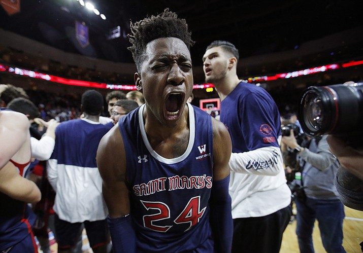 St. Mary's Malik Fitts (24) celebrates after his team defeated Gonzaga 60-47 for the West Coast Conference men's tournament title, Tuesday, March 12, 2019, in Las Vegas. (John Locher/AP)