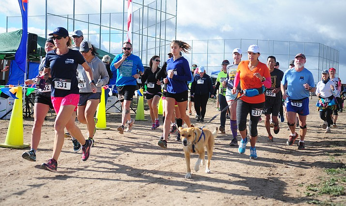 The 5K and Community Fair is slated for March 23. Runners from a 5k in 2016 Extreme Spring Fling is pictured. (Les Stukenberg/Review, file)