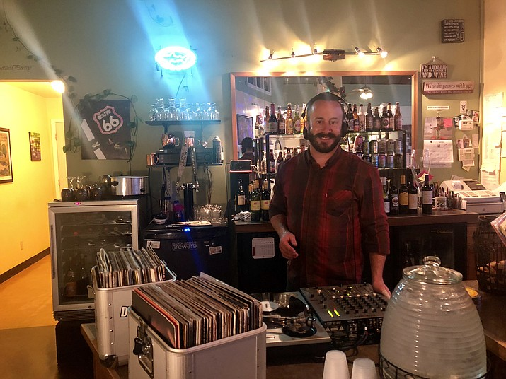 Jeremiah Green turning tables at Diana's cellar Door on Monday. The next Vinyl Night is in two weeks, at 6 p.m. on Monday, March 25. (Photo by Agata Popeda/Daily Miner)