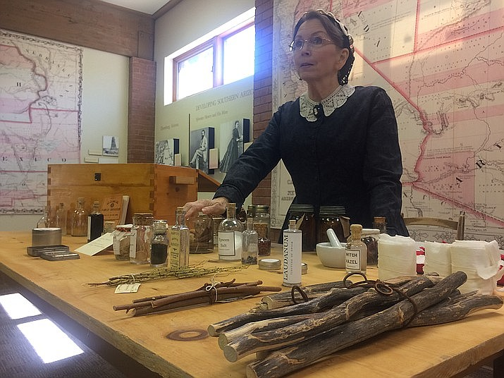Bi Sallomi shows off the contents of a typical medicine box a housewife of the frontier would have during the Sharlot Hall Museum's Arizona History Adventure Saturday, March 9. (Jason Wheeler/For The Daily Miner)