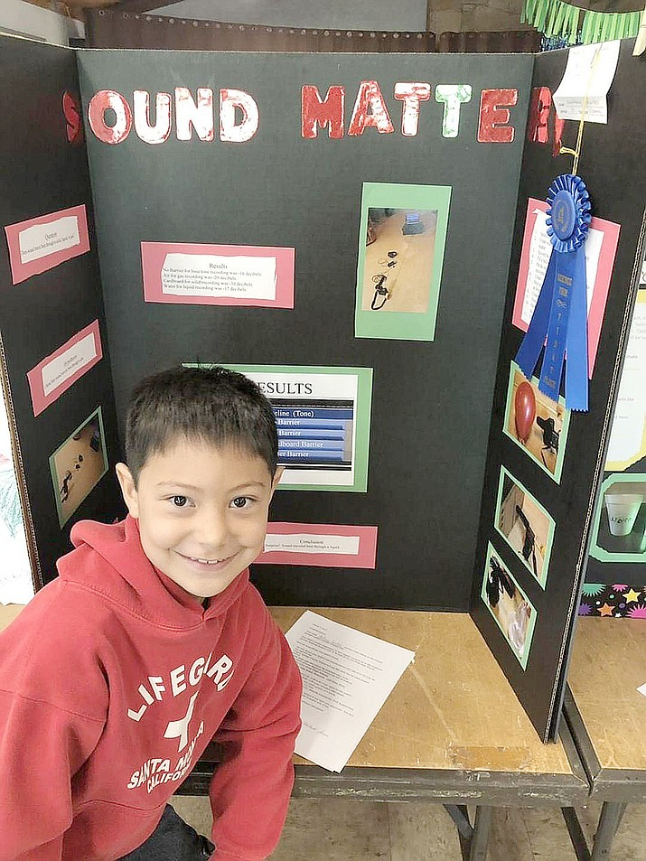 """Anthony Santos, a third-grader at Mingus Springs Charter School, poses with his """"Sound Matter!"""" science project — which earned a first-place ribbon in the school's 2018-19 Science Fair on Wednesday, March 6. Fourteen students from the school earned first-place ribbons and will be invited to the Yavapai County Science Fair on Friday, March 29, at Tri City College Prep High School in Prescott. The other winners are second-graders Evan Schaller and Eli Furr; third-graders Logan Nagle, James Hines and Braydon King; fourth-graders Konner Nagle, Elijah Christopher, Travis Minkus, Brandon Widtfeldt and Iris Purcell; fifth-grader Body Allen; sixth-grader Alex Furr; and seventh-grader Brody King. (Matt Santos/Courtesy)"""