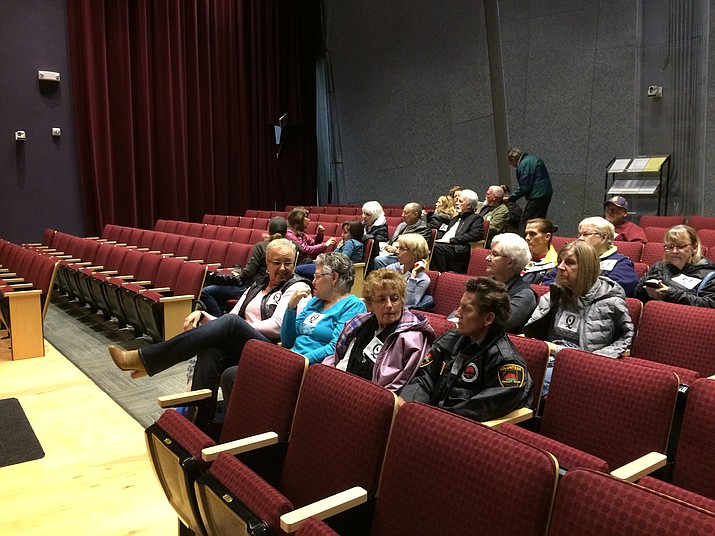 Residents of Quailwood chat before the March 11 Planning and Zoning Commission meeting in the Prescott Valley Public Library auditorium. The Commission tabled the agenda items dealing with Dorn Homes' requested zoning map change near Quailwood to a future unspecified date. (Sue Tone/Tribune)