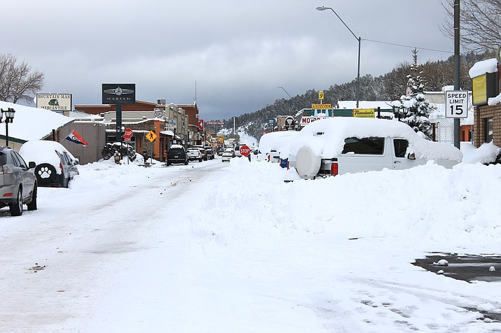 City crews had difficulty navigating snow removal equipment because of vehicles that were left parked on the streets in last month's storm. (Wendy Howell/WGCN)