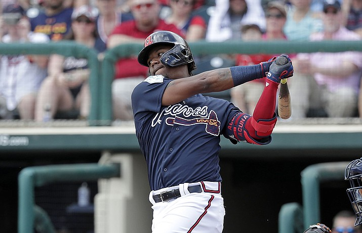 Atlanta Braves' Ronald Acuna Jr. bats against the Houston Astros, Monday, March 4, 2019, in Kissimmee, Fla. (John Raoux/AP file)
