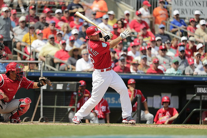 St. Louis Cardinals' Paul Goldschmidt hits a double in the third inning during a spring game against the Washington Nationals on Monday, March 11, 2019, in Jupiter, Fla. (Brynn Anderson/AP)
