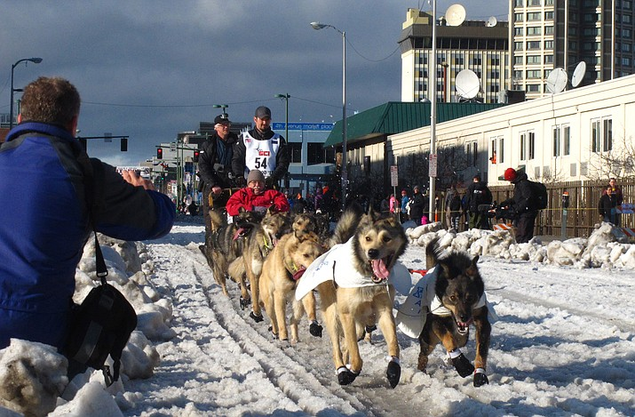 In this March 7, 2015, file photo, musher Peter Kaiser, of Bethel, Alaska, leads his team past spectators during the ceremonial start of the Iditarod Trail Sled Dog Race, in Anchorage, Alaska. Kaiser has become the latest Alaska native to win the Iditarod dog sled race. Kaiser won the race for the first time early Wednesday, March 13, 2019, crossing the finish line in Nome after beating back a challenge from the defending champion, Norwegian musher Joar Ulsom. (Rachel D'Oro/AP, File)