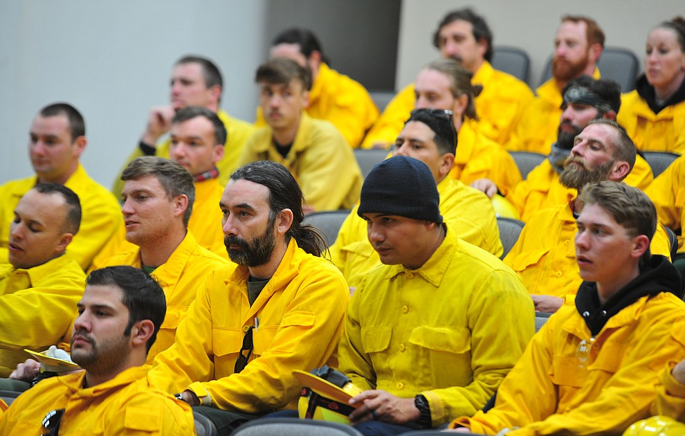 Arizona Wildfire & Incident Management Academy's 92 students in four S130/190 Basic Wildland Firefighting classes prepare to go out on their field day at Embry Riddle Aeronatical University, Wednesday, March 13, 2019, in Prescott. (Les Stukenberg/Courier)